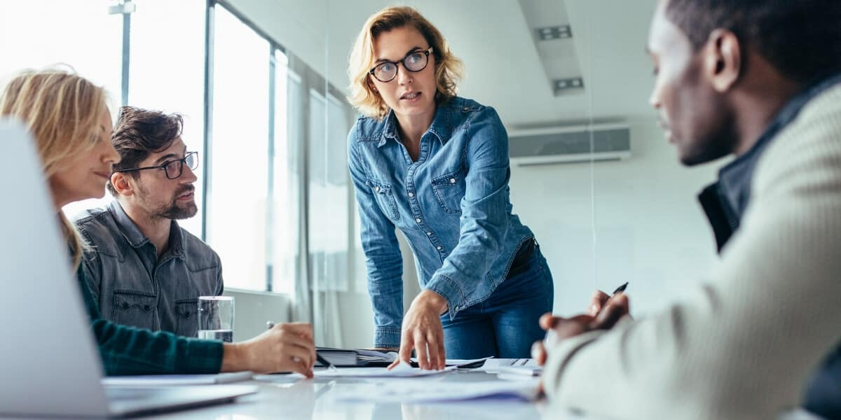 Woman pointing at project on desk
