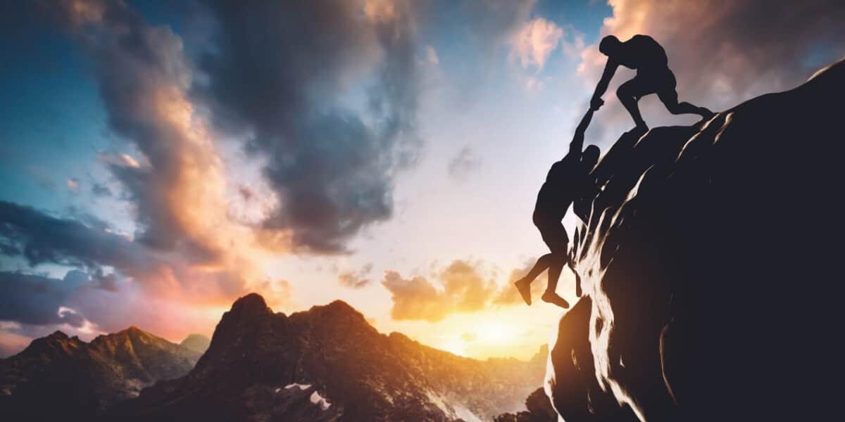 Two men climbing mountain
