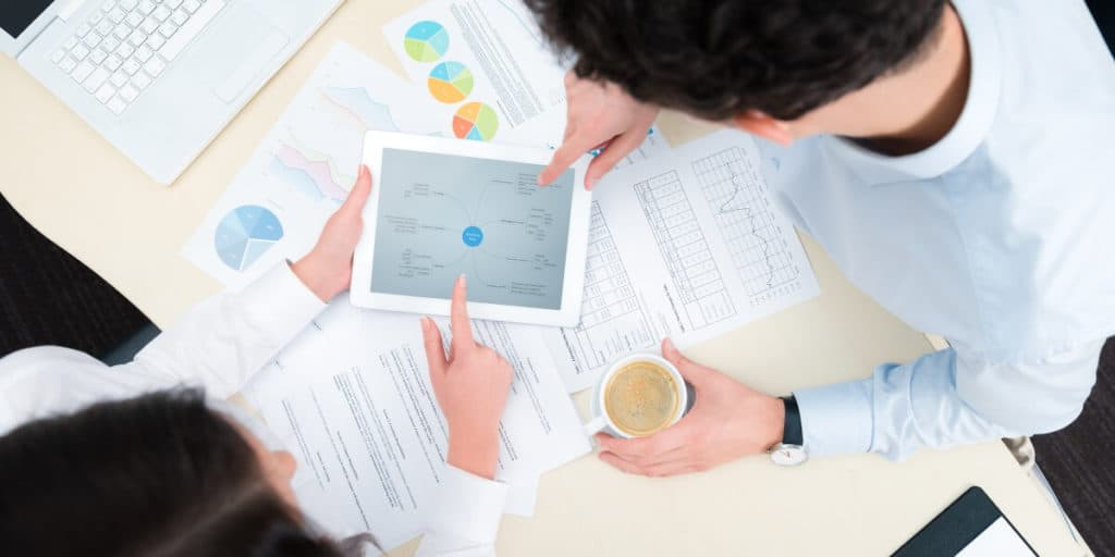 man and woman creating business plan