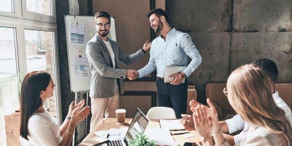 employee receiving promotion in office