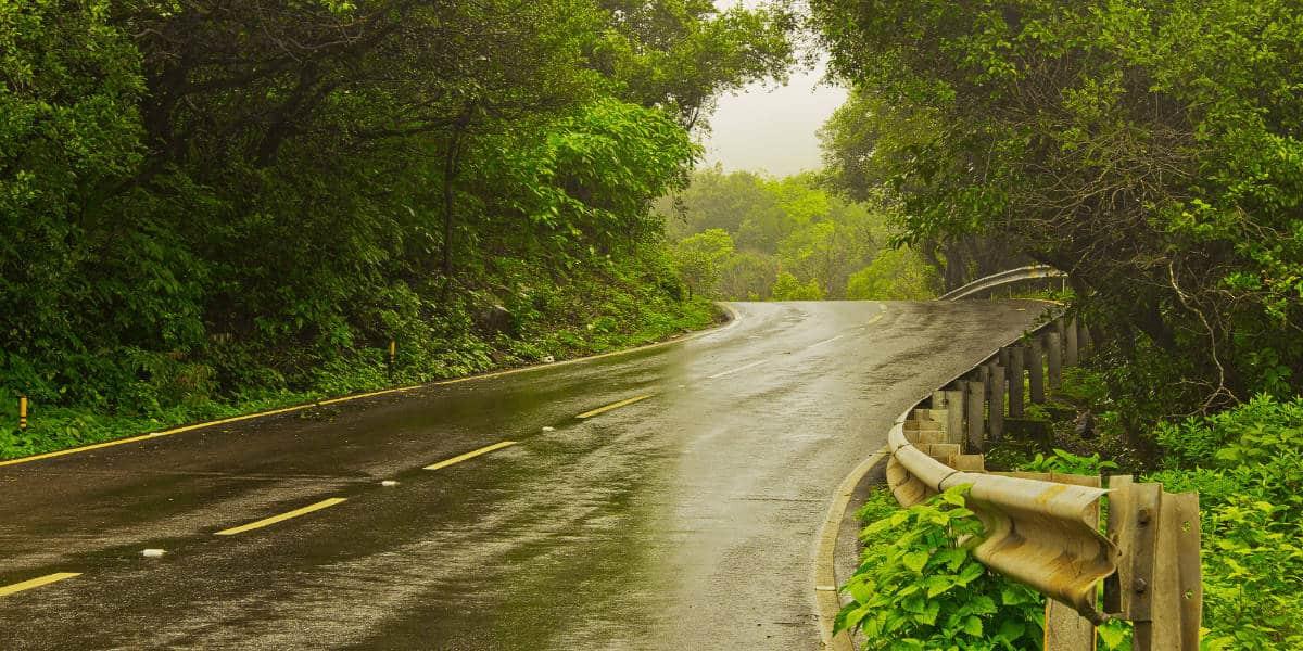 Winding road during rain shower (1)