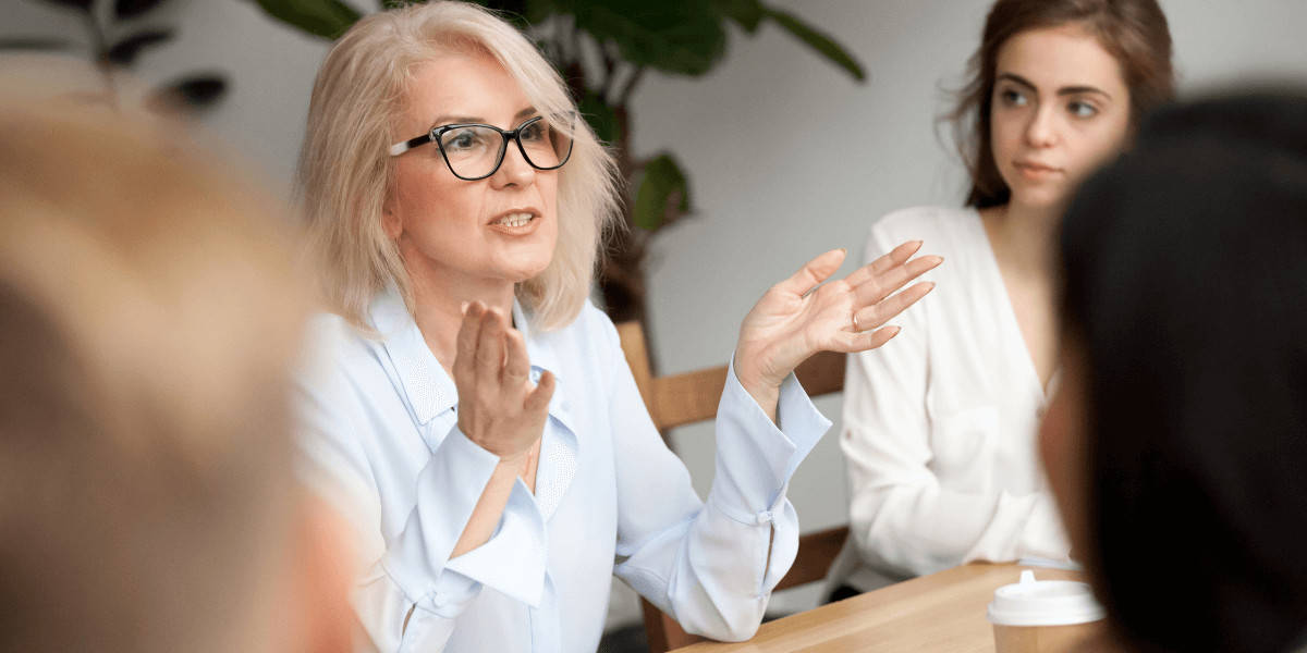 Woman speaking to employees