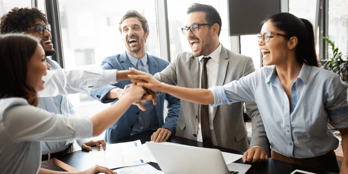 employess celebrating success with high fives