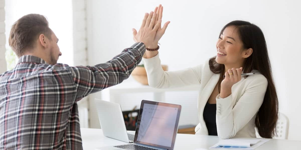 Coworkers celebrating - How to become an executive coach